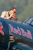 Eric Goujon refuels the Vought F4U-4 Corsair aircraft from the Flying Bulls Collection. Payerne, Switzerland - September 6, 2014: Eric Goujon refuels the Vought stock photography