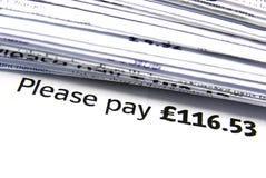 Payez s'il vous plaît en livres Image stock