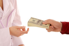 Paying. Closeup image of the patient paying to the doctor Stock Photography