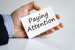 Paying attention text concept Royalty Free Stock Images