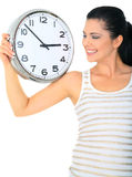 Paying Attention To Clock. Happy woman or mom looking at clock showing 3 o'clock stock photo
