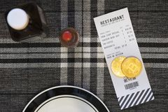 Paying a bill with Bitcoin or other crypto currency at a restaurant royalty free stock photography