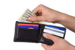 Paying bills. Dishing out cash from a leather wallet to pay bills Royalty Free Stock Images