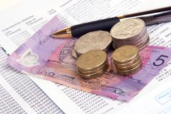 Paying the bills. Australian currency on c/c statement Royalty Free Stock Photos