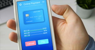 Paying for bills with credit card using smartphone application stock video