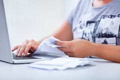Paying bills from home Stock Photos