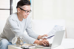 Paying bills online using computer Stock Photos