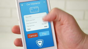 Paying for car insurance bill using smartphone application. Using app on the smartphone stock footage
