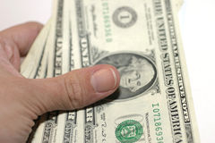 Paying Cash. Holding three 1 Dollar bills. Shallow DOF stock photography