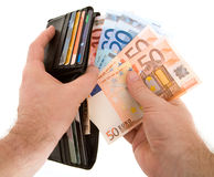 Paying Cash with Euro Currency Royalty Free Stock Image