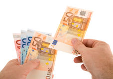 Paying Cash with Euro Currency Royalty Free Stock Photos