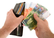Paying Cash with Swiss Francs Currency Royalty Free Stock Images