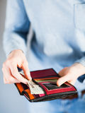 Paying in Cash. Woman paying with cash from her wallet. Closeup with shallow DOF Royalty Free Stock Images