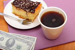 Paying for cheesecake and coffee in the cafe, finance concept Royalty Free Stock Image