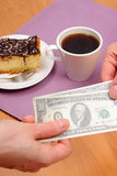 Paying for cheesecake and coffee in the cafe, finance concept Royalty Free Stock Photos