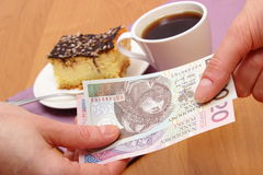 Paying for cheesecake and coffee in the cafe, finance concept Stock Photo
