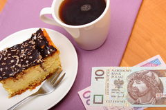 Paying for cheesecake and coffee in the cafe, finance concept Royalty Free Stock Photography