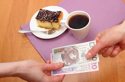 Paying for cheesecake and coffee in the cafe, finance concept Stock Photography