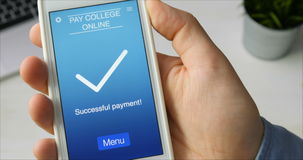 Paying for college education online using smartphone app stock video footage
