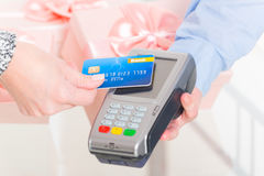 Paying with contactless credit or debit card Royalty Free Stock Image