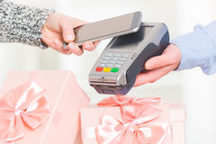 Paying contactless with smart phone Royalty Free Stock Images