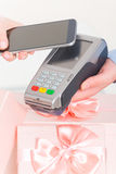 Paying contactless with smart phone Royalty Free Stock Photos
