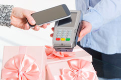 Paying contactless with smart phone Royalty Free Stock Photography