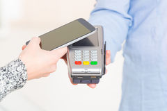 Paying contactless with smart phone Royalty Free Stock Photo