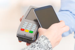 Paying contactless with smart phone Stock Images