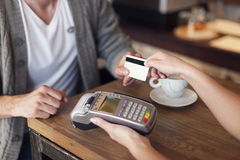 Paying by credit card. Close up of customer paying by credit card Royalty Free Stock Photography