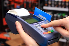 Paying with credit card in an electrical shop, finance concept Royalty Free Stock Photos