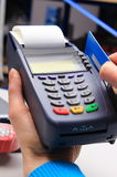 Paying with credit card in an electrical shop, finance concept Royalty Free Stock Image