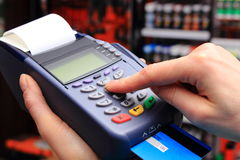 Paying with credit card in an electrical shop, finance concept Royalty Free Stock Images