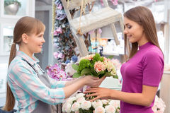 Paying with credit card at florist shop Royalty Free Stock Photos