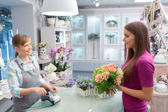 Paying with credit card at florist shop Stock Image
