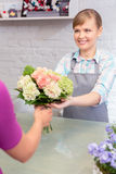 Paying with credit card at florist shop Stock Photo
