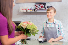 Paying with credit card at florist shop Stock Photography
