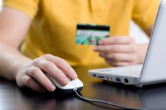 Paying with a credit card online. Online shopping concept, paying with a credit card Stock Images