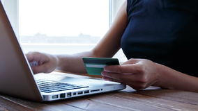 Paying with credit card online on wooden desk stock footage
