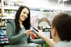 Paying credit card for purchases. Supermarket collection: Paying credit card for purchases Stock Image