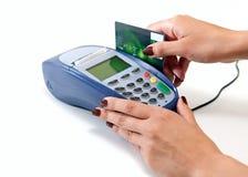 Paying with credit card through terminal. Moment of payment with credit card through terminal Royalty Free Stock Image