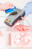 Paying with credit or debit card for a gifts Royalty Free Stock Images
