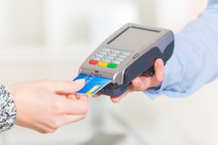 Paying with credit or debit card. In wireless payment terminal at shop stock photos