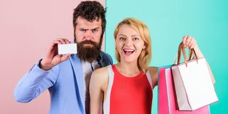 Paying while dating. Couple with luxury bags in shopping mall. Couple enjoy shopping. Man bearded hipster hold credit. Card and girl enjoy shopping. Ask men to stock images
