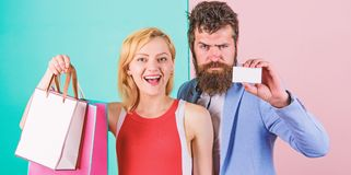 Paying while dating. Couple with luxury bags in shopping mall. Couple enjoy shopping. Man bearded hipster hold credit stock images