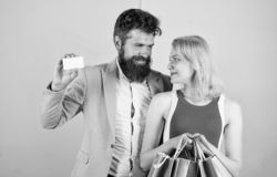 Paying while dating. Couple with luxury bags in shopping mall. Man bearded hipster hold credit card and girl enjoy stock photos