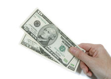Paying In Dollars. Hand holding dollars, showing $10 bill - on white Royalty Free Stock Images
