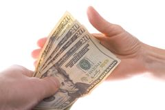 Paying Dollars. Bunch of twenty dollar notes being handed over Royalty Free Stock Photography