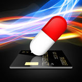 Paying for drugs with a credit card. Medical capsule illustration , isolated on white background stock illustration