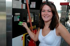 Paying for Gas - Happy Royalty Free Stock Photos